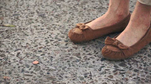 Finding a Lost Penny on the Street Stock Video Footage