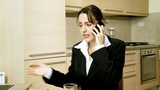 businesswoman working on tablet answering the phone in the morning Animation