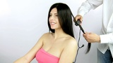 fashion model getting hair ironed by hairdresser medium shot Animation