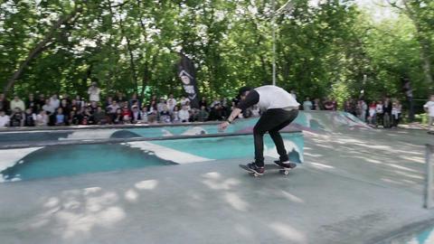Skater make extreme jumps in skate park. Contest. Slow motion Live Action