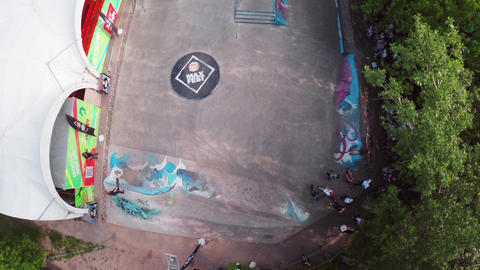 Quadrocopter shoot skate park with skater and people. Summer day Footage