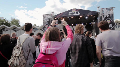 Back side of audience on summer live festival. Studycam. Performance on stage Footage