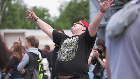 Adult man dance and shout at live summer festival among other people Slow motion Live Action