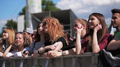 Attractive girls dance at live summer festival among other people Slow motion Footage