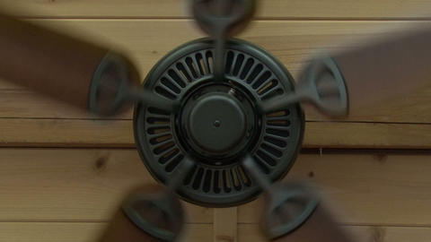 Zoom in to ceiling fan in a wooden house Live Action