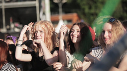 Attractive girls repeat dance movememts at live summer festival among other Footage