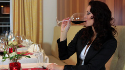Woman Drink Red Wine In A Restaurant stock footage