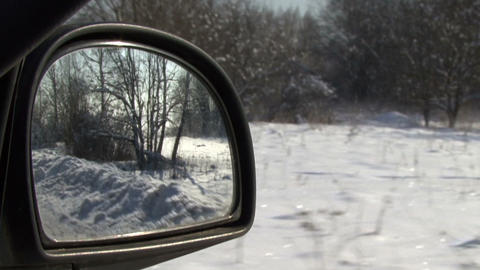 Rear view mirror in the snow-covered field Live Action