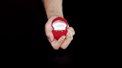 Mans Hands Open Red Ring Box with Gold and Diamond Footage