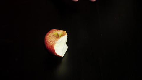 Eating apple on black background. Nibble apple Footage