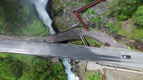 Top-down view of Svandalsfossen waterfall passing below the road in Norway Footage
