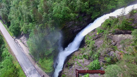 Massive Svandalsfossen waterfall passing below the road in Norway Footage
