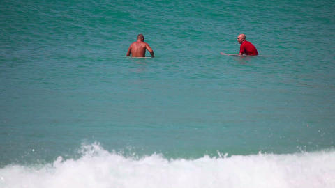 Surfers waiting for waves Footage