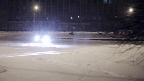 Car skid on snow covered road. Winter street drift Footage