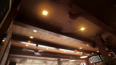 A big cooling ceiling fanin cafe Footage