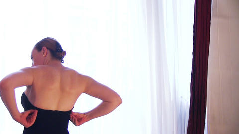 Beautiful Woman Tries On A Dress Footage