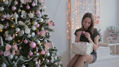 Beautiful teenager girl sorting out christmas balls and decorating the Christmas Footage