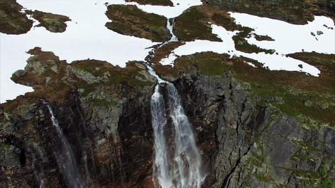 Breathtaking flight over tall waterfall in Norway, aerial footage Footage