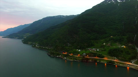 Flying over popular Hardanger fjord in Norway in the evening, aerial footage Footage