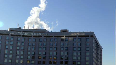 White Smoke Over Slavyanskaya Hotel in Moscow Footage