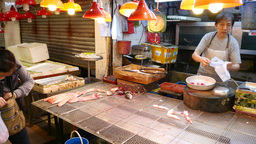 Seafood market, seller pack foods, dynamic view, camera moving around scene Footage