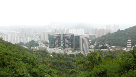 City district at the bottom of mountain, rainy weather, green and urban view Footage