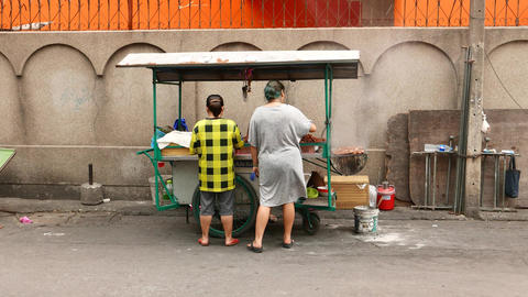 Mobile stall on roadside, Thai street food cooking, smoke from brazier Footage