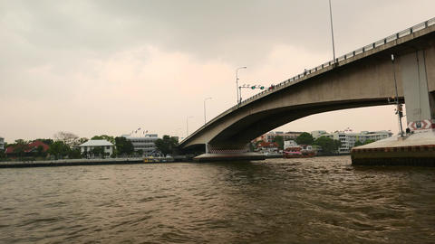Concrete bridge span and support as seen from river water, perspective view Footage