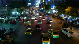 Night traffic at Ratchadamri road, cars turn from parking to crowded driveway Footage