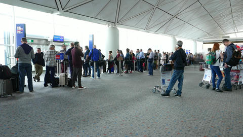 Passengers gather around departure gate door, crowd around, TIMELAPSE shot Footage