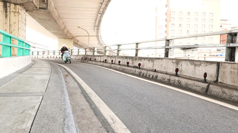Narrow motorbike lane on big junction, curved part, scooters traffic Footage