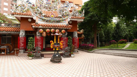 Small inner-city temple, small park beside, live camera Footage