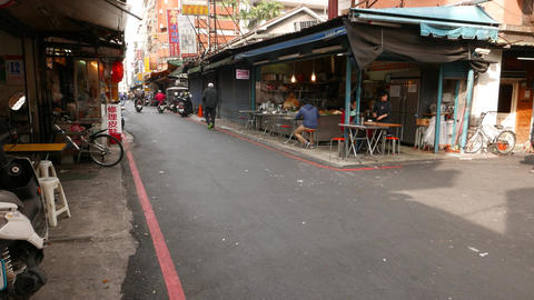 Typical quiet street of Taipei city. Street restaurant under canopy Live Action