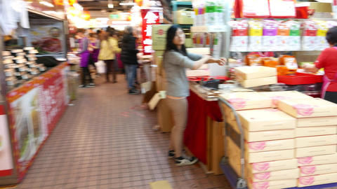 Huge indoor market, sellers prepare to busy shopping time, pack products Footage