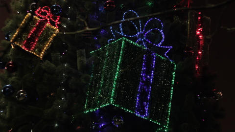 1080p Ungraded: Decorated Christmas Tree With Flashing Gift Boxes and Glowing Footage