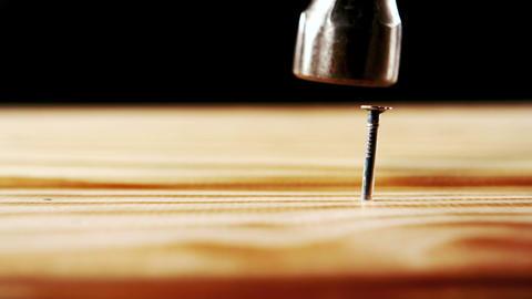 Hammer hammering nail into wood Footage