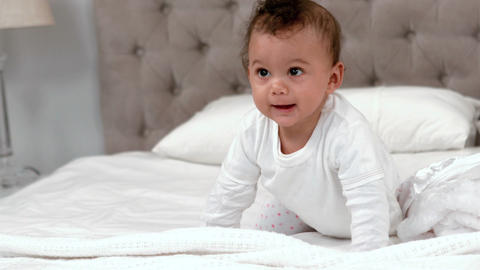 Baby in white clothes crawling Footage