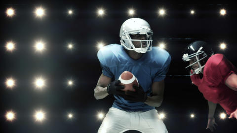 American football players against flashing lights Animation