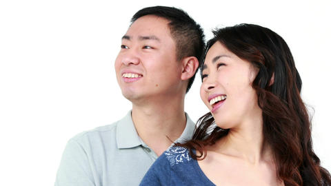 Happy Asian couple hugging Footage
