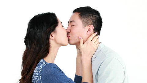 Happy Asian couple kissing and smiling Footage