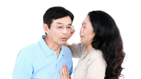 Mature Asian couple telling secrets to each other Footage