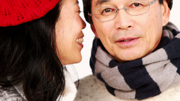 Mature Asian couple holding coffee cups and talking Footage