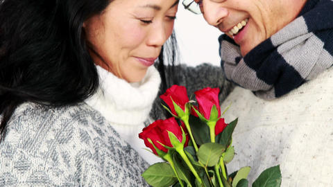 Mature Asian couple holding roses Footage