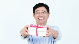 Middle-aged Asian man holding a present Footage