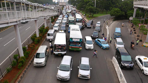 Traffic jam, at unpaid road, empty parallel toll way Footage