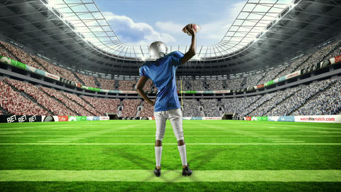 American football player triumphing with raised arms Footage