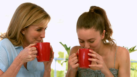 Mother And Daughter Drinking And Talking stock footage