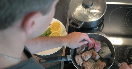Man cooking tasty supper at home Footage