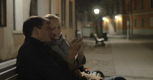 Happy couple making selfie in evening street Footage
