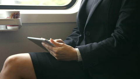 Businesswoman using her tablet on the train Footage